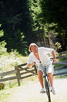 Austria, Salzburg County, Mid adult man riding old bicycle