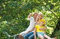 Austria, Salzburg County, Family sitting on fence