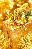 Christmas gift on a gold sparkling background