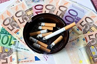 Smoking costs money, euro bank notes and ashtray
