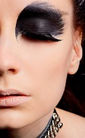 close_up portrait of beautiful girl with bird of prey fantasy make_up