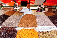Dried fruits, nuts, dates and almonds at a market stall, on the Djemaa el Fna market place in the Medina, historic district, UNESCO World Heritage sit...
