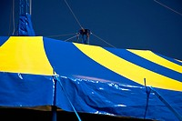 Yellow and blue tent before blue sky