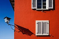 Red facade with the shadow of a lamp shade, Stein am Rhein, Canton of Schaffhausen, Switzerland, Europe