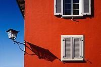 Red facade with the shadow of a lamp shade, Stein am Rhein, Canton of Schaffhausen, Switzerland, Europe