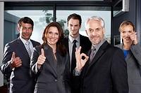 Business team doing OK sign