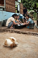 Girls washing dishes outdoors at a well in the Mae La refugee camp, Tak province, Thailand, Asia