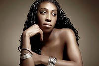 Portrait of a young dark-skinned woman wearing silver jewellery, beauty shot