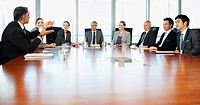 Business people meeting at table in conference room
