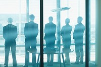 Silhouette of business people in a row looking out office window (thumbnail)