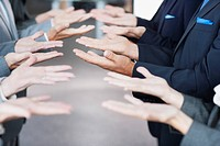 Business people standing in row with palms up (thumbnail)