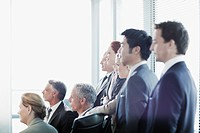 Business people watching presentation in conference room
