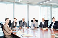 Portrait of smiling business people at table in conference room