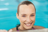 Close up portrait of smiling woman in swimming pool
