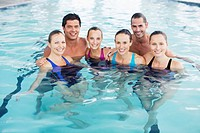 Portrait of smiling people in swimming pool