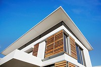 Low angle view of wood shutters on modern house (thumbnail)