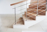 Wooden staircase and railing in modern house (thumbnail)
