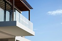 Glass balcony on modern house (thumbnail)