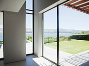 View of lake from window of modern house