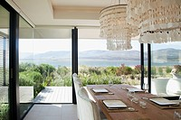 Dining room overlooking lake in modern house