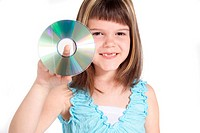 A young girl holding a cd or dvd. All isolated on white background.