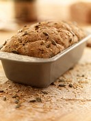 Close up of rustic bread in loaf pan
