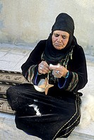 old Bedouin woman at home in the village of Um-Sayhoun where are living the most part of Bedoins working on the Petra site, Jordan, Middle East, Asia
