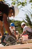 Carpenters using circular saw at a construction site