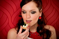 Cocktail party woman eat appetizer evening dress red background
