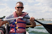Man with spinal cord injury outrigger canoeing in the sea