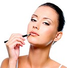 beauty woman applying lipstick on lips with brush _ isolated