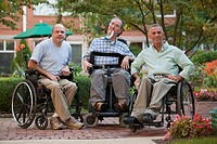 Three men sitting in wheelchairs