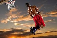 Black man playing basketball