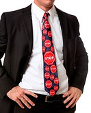 A business man with a themed stop sign tie