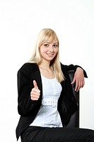 Young woman giving the thumbs up