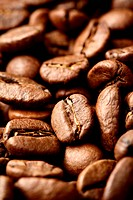 Coffee beans close_up, may be used as background. Shallow DOF!