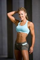 fit model posing in sportswear
