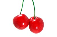 a pair of cherries isolated on a white background