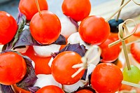 small tomatos cherry with mozzarella on skewer