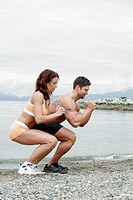 couple exercising outside together doing a leg workout