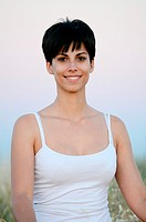 Attractive short haired woman in nature