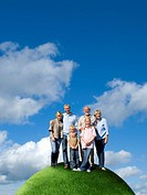 Multi_generational family on top of grassy globe