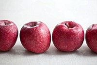 A row of red apples