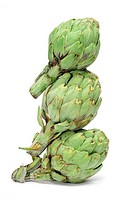 a pile of artichokes on a white background