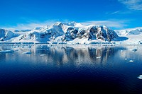 blue sea and snowy antarctic mountains