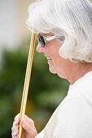 Close_up of a senior woman playing shuffleboard