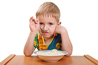 Little cute child eating food in family care