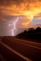 Single lightning bolt hitting the road ahead.