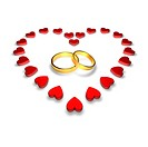 Wedding rings encircled by hearts