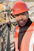 Engineer on a conveyor belt at a construction site